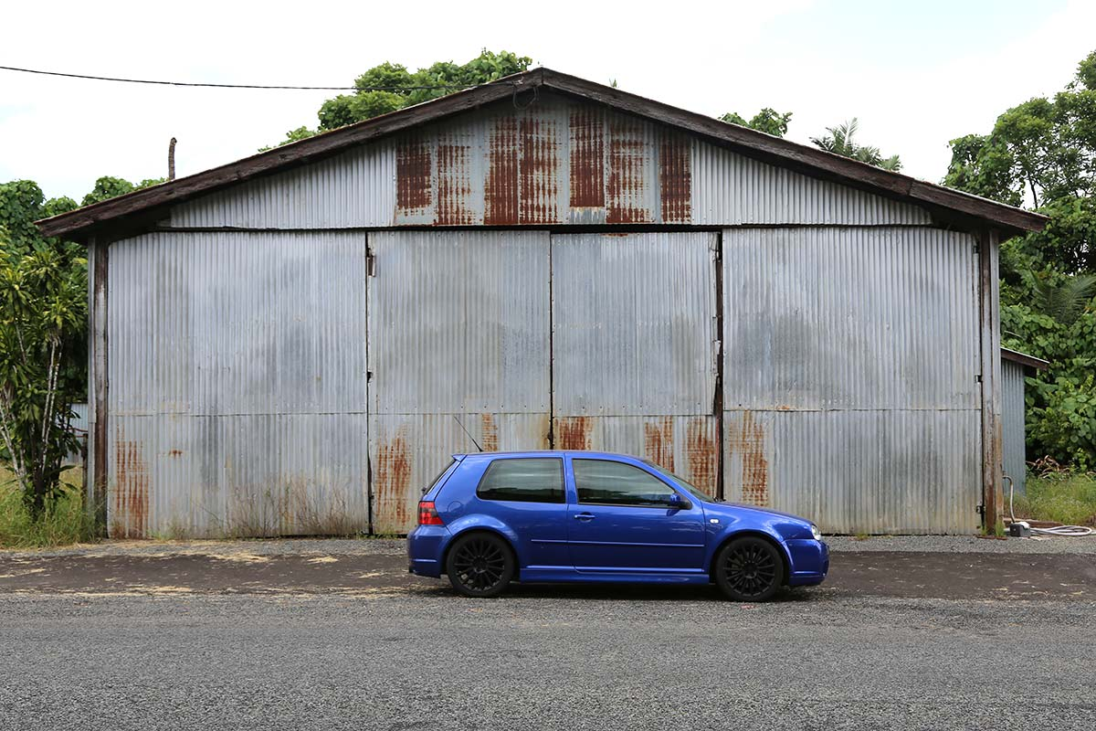2004 VW Golf R32 in front of corrugated iron building